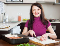 Girl cooking  pie with store-bought dough Royalty Free Stock Photo