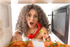 Girl cooking a pizza Stock Image