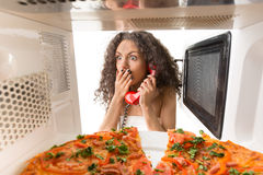 Girl cooking a pizza Stock Photos