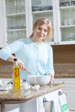 Girl is cooking Stock Image