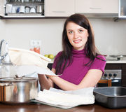 Girl cooking with prepared shop-bought dough Royalty Free Stock Photos