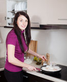 Girl cooking rice noodles with seafood Stock Photography