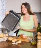 Girl cooking salmon fish Stock Photo