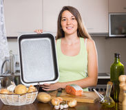 Girl cooking salmon fish Royalty Free Stock Images