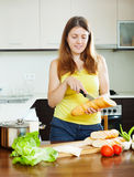 Girl cooking sandwiches Stock Photo