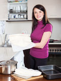 Girl cooking with  shop-bought dough Royalty Free Stock Images