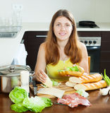 Girl cooking spanish sandwiches (bocadillo) Royalty Free Stock Images