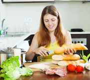 Girl cooking spanish sandwiches Stock Image