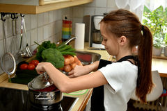 Girl cooking Royalty Free Stock Photography