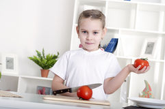 Girl cooking vegetables. Beautiful girl in the kitchen cooking vegetables Royalty Free Stock Photos