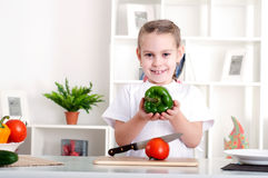 Girl cooking vegetables. Beautiful girl in the kitchen cooking vegetables Royalty Free Stock Photo