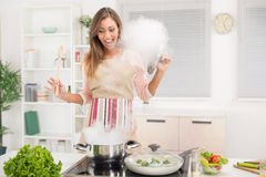 Girl Cooking. Young beautiful woman cooking healthy meal in the kitchen Stock Photography