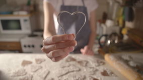 Girl cooks biscuits for Valentines Day. heart shape stock footage