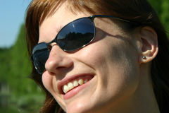 Girl with cool shades. Cute girl in the sun with her sunglasses on Stock Photo