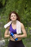 Girl cooling off after workout. A girl cools off after working out in Central Park New York.  She was 26 at time of shoot and is Jewish American.  Photographed Stock Photos