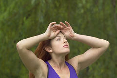 Girl cooling off after workout. A girl cools off after working out in Central Park New York.  She was 26 at time of shoot and is Jewish American.  Photographed Royalty Free Stock Photography