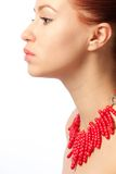 Girl with coral necklace Stock Photos