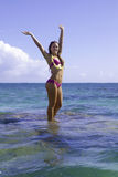 Girl on coral in the ocean Stock Image