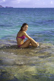 Girl on coral in the ocean Royalty Free Stock Images