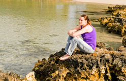 Girl on coral reef royalty free stock photography