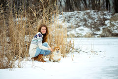 Girl and corgi fluffy puppy portrait Stock Photo