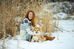 Girl and corgi fluffy puppy portrait Royalty Free Stock Photography