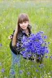 Girl with cornflower Stock Photos