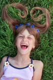 Girl with cornflowers in her hair emotional laughing Stock Images