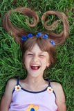 Girl with cornflowers in her hair emotional laughing Royalty Free Stock Images
