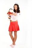 Girl with corona and toy Stock Photo
