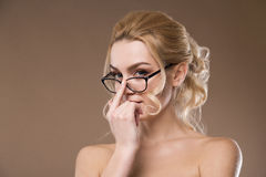 Girl corrects glasses Royalty Free Stock Photo