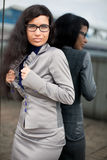 The girl corrects a jacket Royalty Free Stock Photos