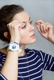 Girl corrects make-up Stock Photo