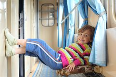 Girl in corridor of railway car Royalty Free Stock Photography