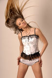 The girl in a corset. With hair in movement Royalty Free Stock Image