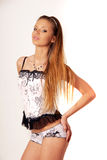 The girl in a corset. The girl in white corset Stock Photo