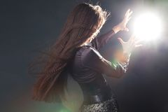 Girl in corset and long skirt, medieval witch does spells. royalty free stock photos
