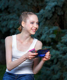 Girl with a cosmetic bag. Girl in a white T-shirt with a cosmetic bag Stock Photo