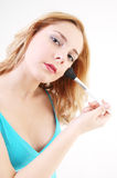 Girl with cosmetic brush Stock Image