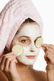 Girl in cosmetic mask Stock Photo