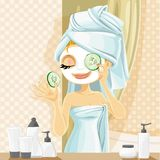 Girl in a cosmetic mask pack puts cucumbers on eyes in the bathroom Royalty Free Stock Photos