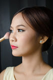 Girl with Cosmetic. Girl in cosmetic testing session Stock Photos