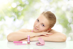 Girl with cosmetics Royalty Free Stock Image