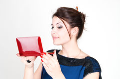 Girl and cosmetics bag Stock Images