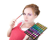 Girl with cosmetics brushes. Young beautiful girl with cosmetics brushes Stock Photo