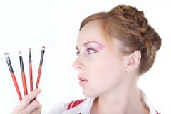 Girl with cosmetics brushes. Young beautiful girl with cosmetics brush Stock Image