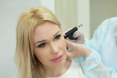 Girl in cosmetology Stock Images