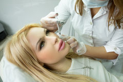Girl in cosmetology Royalty Free Stock Images