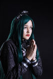 Girl cosplay anime character pray in dark. Girl smile cosplay anime character pray in dark portrait royalty free stock photos