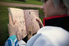 Girl Cosplayer of Sakata Gintoki from Gintama reading Weekly Shonen Jump stock photo